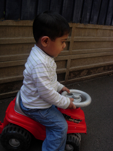 Boy playing outside on a bike at Early Learners' Nursery School, Leicester