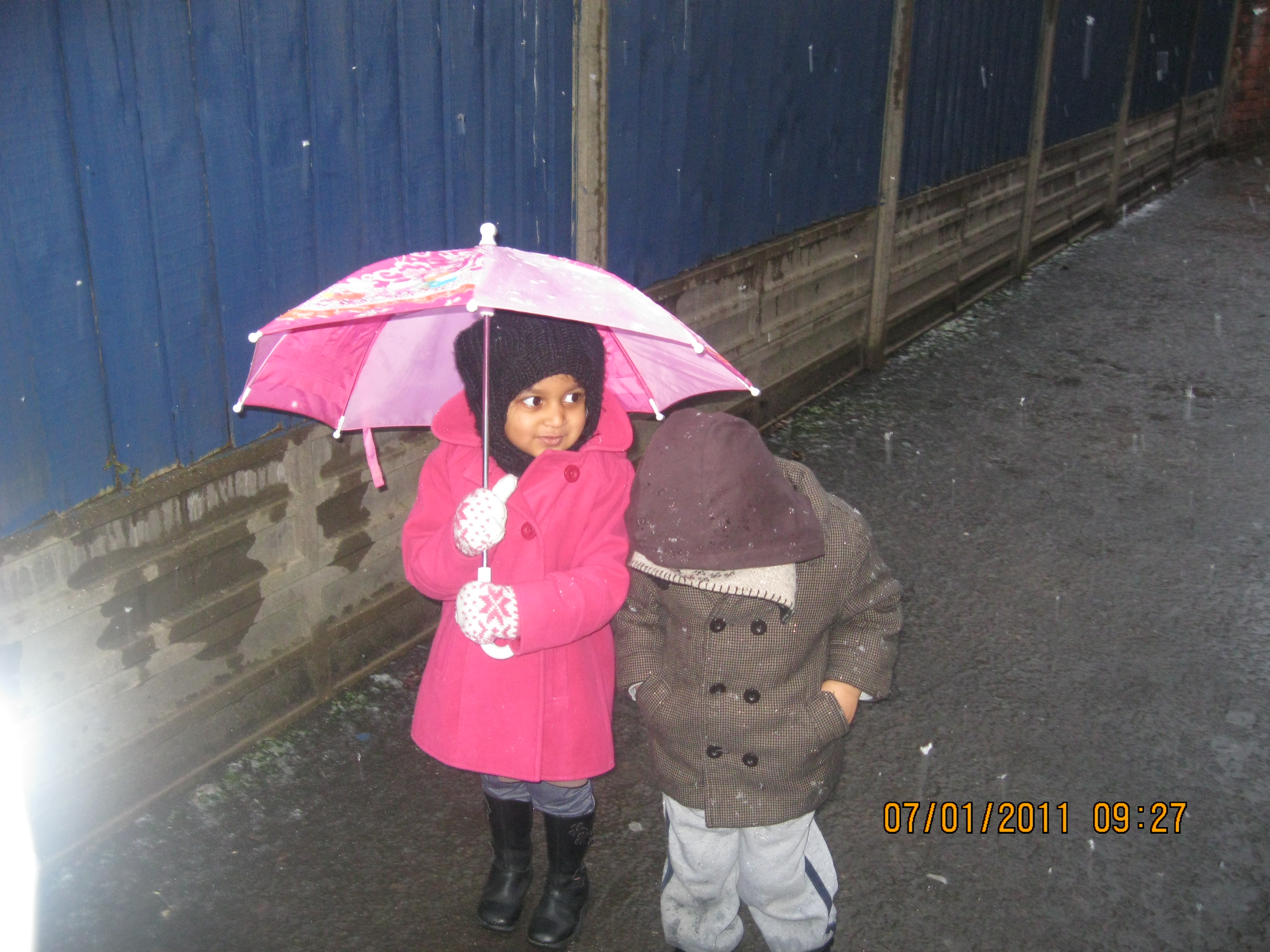 Girl with an umbrella at Early Learners' Nursery School, Leicester